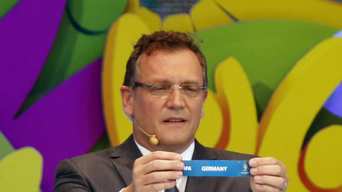 """FIFA Secretary General Jerome Valcke holds the slip showing """"Germany"""" during the draw for the 2014 World Cup at the Costa do Sauipe resort in Sao Joao da Mata"""