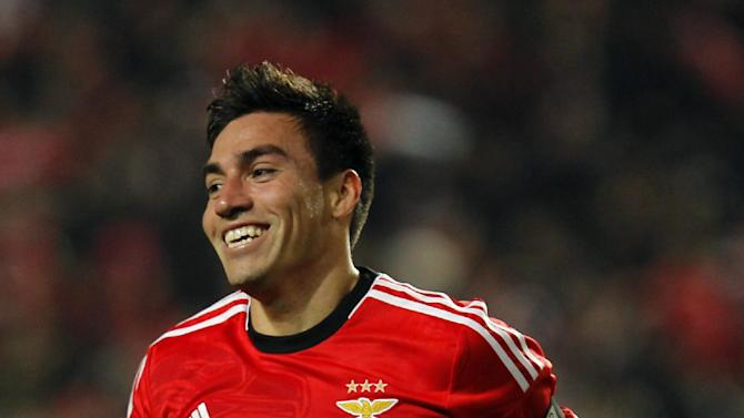 Benfica's Nico Gaitan, from Argentina, celebrates after scoring the opening goal of the game against Sporting during the Portuguese league soccer match between Benfica and Sporting at Benfica's Luz stadium, in Lisbon, Tuesday, Feb. 11, 2014