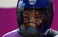 Britain's Lizzy Yarnold takes part in a training session for the women's skeleton event at the Sanki Sliding Center during the Sochi Winter Olympics, on February 10, 2014