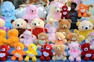 An Indian vendor holds soft toys as he waits for customers at his stall in Amritsar on February 29. India's economic growth will pick up speed over the next two years, a report card on Asia's third-largest economy forecast on Thursday, a day before the government presents its budget