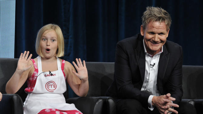 "FILE - In this Aug. Sarah, a contestant on the FOX show ""Master Chef Junior,"" makes fun of judge/executive producer Gordon Ramsay during a panel discussion on the show at the FOX 2013 Summer TCA press tour in Beverly Hills, Calif. (Photo by Chris Pizzello/Invision/AP, File)"