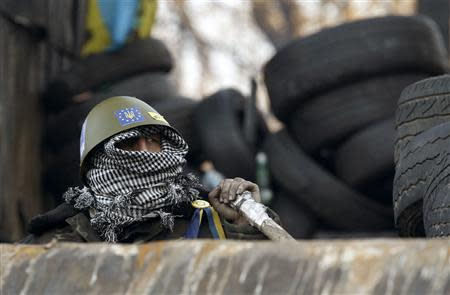 An anti-government protester is seen at the barricades in Kiev February 4, 2014. REUTERS/Vasily Fedosenko