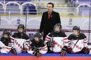 Canada's coach Doug Derraugh stands during the Women's Hockey World Championship group A match between the USA and Canada, at Malmo Isstadion, in Malmo, southern Sweden, Saturday, March 28, 2015. (AP Photo /TT, Claudio Bresciani)