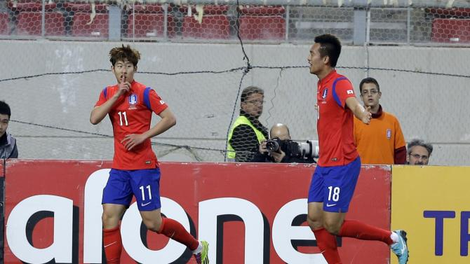 South Korea's Son Heungmin, left, celebrates after scoring the second goal of his team with teammate Kim Shinwook during a friendly match at Georgios Karaiskakis stadium against Greece in Piraeus port, near Athens, Wednesday, March 5, 2014