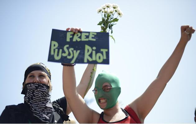 Demonstrators shout slogans in support of the Russian punk group Pussy Riot during a protest in front of the Sagrada Familia church designed by architect Antoni Gaudi in Barcelona, Spain, Friday, Aug.