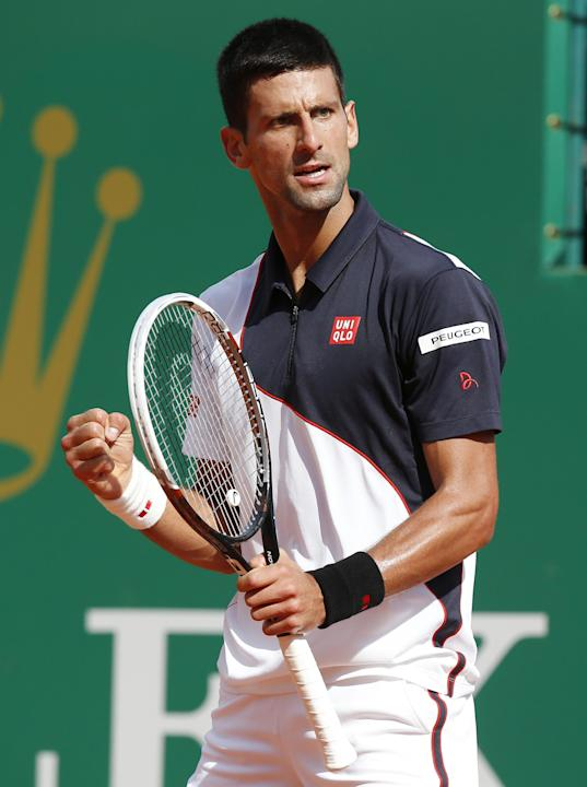 Novak Djokovic of Serbia reacts after scoring a point against Pablo Carreno Busta of Spain during their third round match of the Monte Carlo Tennis Masters tournament in Monaco, Thursday, April 17, 20