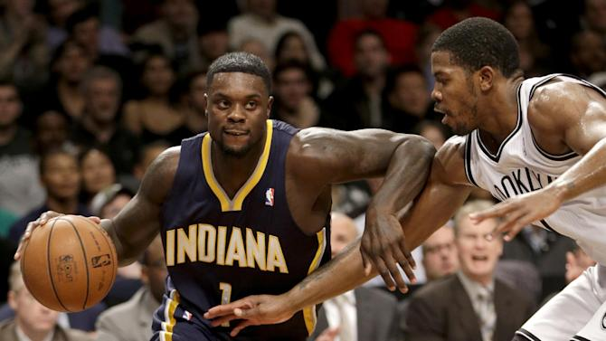 Indiana Pacers' Lance Stephenson, left, pushes past Brooklyn Nets' Joe Johnson during the first half of an NBA basketball game Monday, Dec. 23, 2013 in New York
