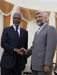 United Nations and Arab League envoy for the crisis in Syria, Kofi Annan (L) shakes hands with Iran's chief nuclear negotiator Saeed Jalili in Tehran. Kofi Annan warned on Tuesday that Syria's deadly conflict could spread across the region as he held talks in Iran and Iraq aimed at shoring up support for his tattered peace plan