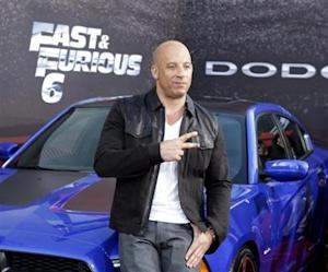 """Cast member and producer Vin Diesel poses at the premiere of the new film, """"Fast & Furious 6"""" at Universal Citywalk in Los Angeles"""