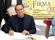 People of Liberty party (PDL) leader Silvio Berlusconi poses as he signs a referendum on justice reforms and human rights in downtown Rome August 31, 2013. REUTERS/Remo Casilli