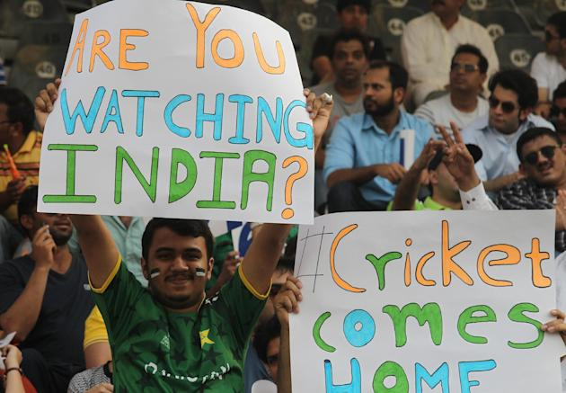 Pakistani cricket fans celebrate at the Gaddafi Stadium in Lahore, Pakistan, Sunday, May 24, 2015. The Twenty20 matches Friday and Sunday mark a return of international cricket to Pakistan for the fir