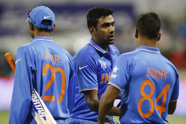 India's Ravichandran Ashwin, centre, is congratulated by teammates Ajinkya Rahane, left, and Stuart Binny following their four wicket win over the West Indies in their Cricket World Cup Pool B mat