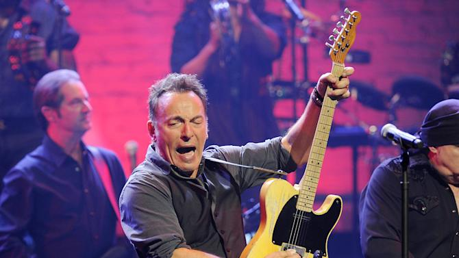 FILE - This March 9, 2012 file photo shows Bruce Springsteen and the E Street Band performing at the Apollo Theater in New York. MusiCares announced Thursday, June 28, that Springsteen will be honored as the 2013 MusiCares Person of the Year in recognition of his extraordinary creative accomplishments as well as his significant charitable work. The 2013 MusiCares Person of the Year gala will be held on Feb. 8, 2013. (AP Photo/Evan Agostini, file)