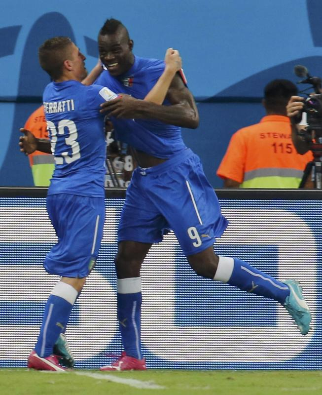 Italy's Balotelli and his Verratti celebrate after Balotelli scored a goal against England during their 2014 World Cup Group D soccer match at the...