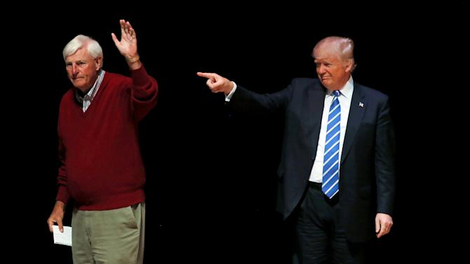 U.S. Republican presidential candidate Donald Trump is joined on stage by former Indiana University basketball coach Bob Knight at a campaign event at the Old National Events Plaza in Evansville, Indiana