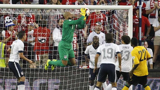 U.S. goalkeeper Tim Howard, center, makes a save on a corner kick by Jamaica in the second half of a World Cup qualifier soccer match at Sporting Park in Kansas City, Kan., Friday, Oct. 11, 2013. The U.S. team won 2-0