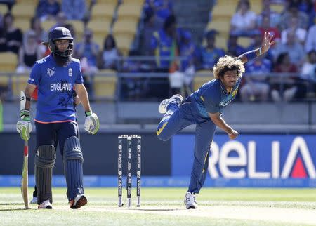 England's Ali watches as Sri Lanka's Malinga bowls during their Cricket World Cup match in Wellington