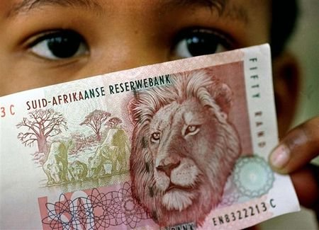 child holds a 50 rand note July 2. The rand sank to a fresh low