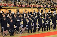"Graduates throw their caps in the air after their graduation ceremony at the National Defense Academy, in Yokosuka, Kanagawa Prefecture, on March 17, 2013. Prime Minister Shinzo Abe urged the graduates to guard against ""provocations"" amid simmering tensions with China over the sovereigniy of an island chain"