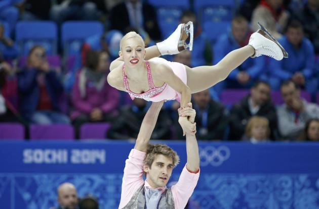 Stacey Kemp and David King during the figure skating team pairs' short program at the Sochi 2014 Winter Olympics