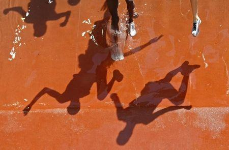 Athletes compete in a men's 3000m steeplechase heat of the athletics competition in the National Stadium at the Beijing 2008 Olympic Games
