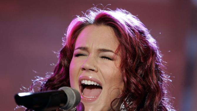 "FILE - In this March 20, 2007 file photo, Joss Stone performs on the NBC ""Today"" television program in New York. A British jury convicted two men on Wednesday, April 3, 2013 of plotting to rob and kill soul singer Joss Stone. Junior Bradshaw and Kevin Liverpool were arrested in June 2011 close to the singer's house after suspicious neighbors reported them to police. They never reached her house. (AP Photo/Richard Drew, File)"