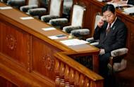 Japanese Prime Minister Yoshihiko Noda sits in his seat at parliament in Tokyo on August 24. Japan's opposition was set Wednesday to file a censure motion against Noda that threatens to stall parliament and bolster calls for snap elections