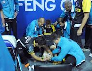 Lee Chong Wei of Malaysia receives medical attention during in his match against Peter Gade of Denmark at the Thomas Cup world badminton team championships in China's central city of Wuhan. Lee was put out for up to a month with a torn ankle tendon at the Thomas Cup, casting serious doubt over his Olympic title bid in London
