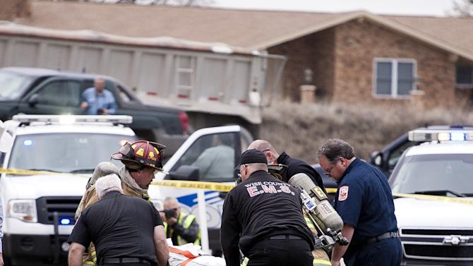 Emergency personnel carry the driver of a black Cadillac with Colorado plates who was involved in a high speed chase and shootout with police in Decatur, Texas, Thursday, March 21, 2013. The driver led police on a gunfire-filled chase through rural Montague County, crashed his car into a truck in Decatur, opened fire on authorities and was shot, officials said.  Texas authorities are checking whether the Cadillac is the same car spotted near the home of Colorado prisons chief Tom Clements, who was shot and killed when he answered the door Tuesday night. (AP Photo/Wise County Messenger, Jimmy Alford) MANDATORY CREDIT, MAGS OUT
