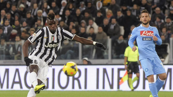 Juventus' Pogba shoots to score a third goal against Napoli during Italian Serie A match in Turin