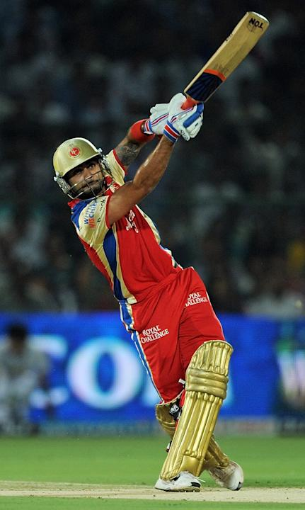 Royal Challengers Bangalore batsman Virat Kohli plays a shot during the IPL match against Rajasthan Royals. Kohli's string of low scores this IPL season continued. He was out for 16 after miscuing a d