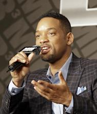 "Actor Will Smith answers a reporter's question during a press conference to promote his new movie ""Men in Black III"" in Seoul, South Korea, Monday, May 7, 2012. (AP Photo/Lee Jin-man)"