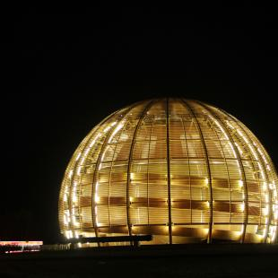 "FILE - In this March 30, 2010 file picture the globe of the European Organization for Nuclear Research, CERN, is illuminated outside Geneva, Switzerland. Two scientific teams have for the first time precisely recorded an extremely rare event in physics that adds certainty to how we think the universe began, leaders at the world's top particle physics lab said Friday July 19, 2013. Two of the teams at the European Center for Nuclear Research, or CERN, say they measured a particle called ""Bs"" decaying into a pair of muons, a fundamental particle. The results are being formally unveiled at a major physics conference in Stockholm later Friday. (AP Photo/Anja Niedringhaus,File)"