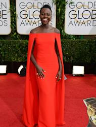 "FILE - In this Jan. 12, 2014 file photo, Lupita Nyong'o arrives at the 71st annual Golden Globe Awards at the Beverly Hilton Hotel, in Beverly Hills, Calif. Nyong'o is nominated for an Oscar for performance by an actress in a supporting role for the film, ""12 Years a Slave."" The 86th annual Academy Awards will be presented on Sunday, March 2, 2014. (Photo by Jordan Strauss/Invision/AP, file)"