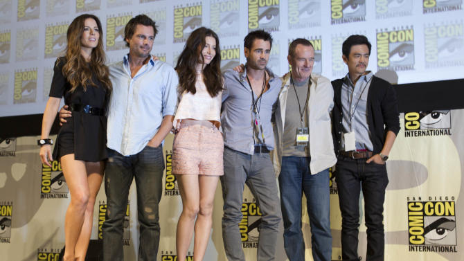 "Cast and crew members of the movie, ""Total Recall"" pose during the Sony panel at Comic Con  Friday, July 22, 2011, in San Diego. They are, from left, Kate Beckinsale, Len Wiseman, Jessica Biel, Colin Farrell, Bryan Cranston, and John Cho. (AP Photo/Gregory Bull)"