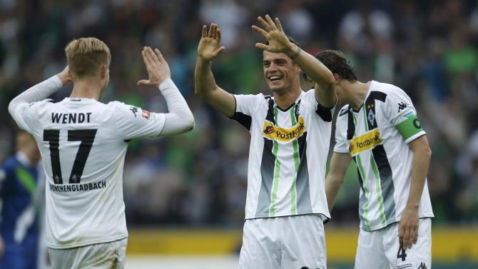 Borussia Moenchengladbach's Wendt, Xhaka and Brouwers celebrate victory against VfL Wolfsburg after their Bundesliga first division soccer match in Moenchengladbach