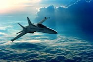 Ten Ways Cloud Computing Is Revolutionizing Aerospace And Defense image jet above the clouds