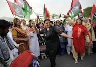 Women activists of the ruling Pakistan People's Party (PPP) dance as they celebrate the election of Raja Pervez Ashraf as Pakistan's new prime minister outside the lower house of parliament in Islamabad