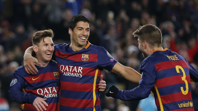 Barcelona's Gerard Pique, right, celebrates with Lionel Messi, left and Luis Suarez after he scored his team's 4th goal during the Group E Champions League soccer match between Barcelona and Roma at the Camp Nou stadium in Barcelona, Spain, Tuesday Nov. 24, 2015. (AP Photo/Emilio Morenatti)