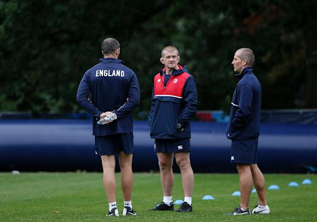 England's assistant coaches Andy Farrell (L) and Graham Rowntree (C) listen to Engliand's head coach Stuart Lancaster (R) during a training session on September 16, 2015, in Bagshot, England,