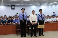 Bo Xilai stands in the Jinan Intermediate People's Court as his corruption verdict is read out, on September 22, 2013