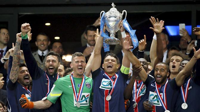 Paris St Germain's captain Silva reacts with by team mates after winning the French Cup final soccer match against Auxerre at the Stade de France stadium in Saint-Denis