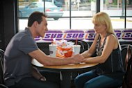 "In this image released by Universal Pictures, Chris Klein, left, and Mena Suvari are shown in a scene from ""American Reunion"". (AP Photo/Universal Pictures, Hopper Stone)"
