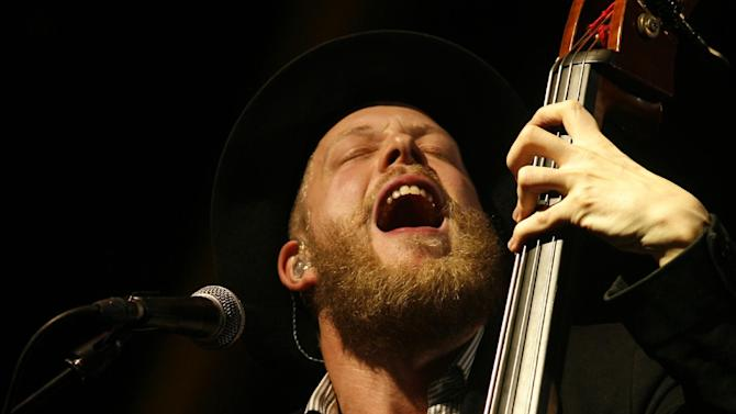 Ted Dwane, bass player for Mumford & Sons performs at the Glastonbury Music Festival at Glastonbury, England on Sunday, June 30, 2013. Ted Dwane had surgery for a blood clot on his brain earlier this month.Thousands are enjoying the three day festival that started on Friday, June 28, 2013 with headliners, Arctic Monkeys, the Rolling Stones and Mumford and Sons. (Photo by Jim Ross/Invision/AP)