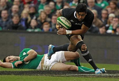 New Zealand's Julian Savea goes over for a try as Ireland's Conor Murray looks on in their International rugby union match at Aviva stadium in Dublin