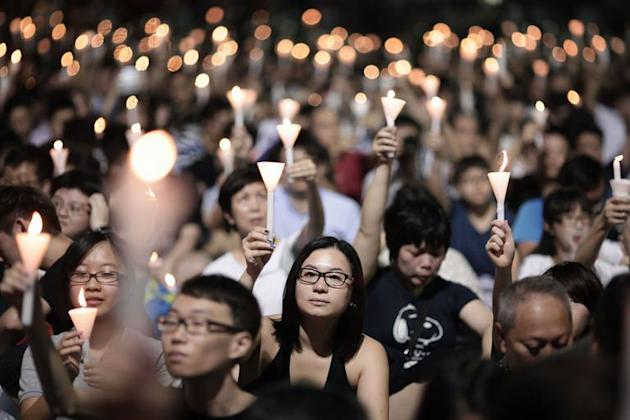 People take part in a candlelight vigil held to mark the 24th anniversary of the 1989 crackdown at Tiananmen Square, in Hong Kong, on June 4, 2013
