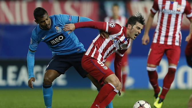 Atletico's David Villa, right, in action with Porto's Alex Sandro, left, during a Champions League Group G soccer match between Atletico Madrid and FC Porto, at the Vicente Calderon stadium in Madrid, Wednesday, Dec. 11, 2013