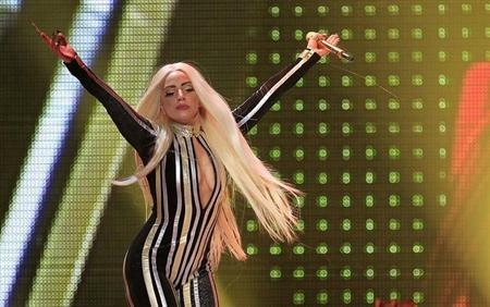 """Lady Gaga performs onstage during the Rolling Stones final concert of their """"50 and Counting Tour"""" in Newark, New Jersey, December 15, 2012 REUTERS/Carlo Allegri"""
