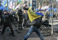 Anti-government protesters throw stones towards Interior Ministry officers during a rally near the building of Vekhovnaya Rada, Ukraine's house of parliament, in Kiev, February 18, 2014. REUTERS/Gleb Garanich
