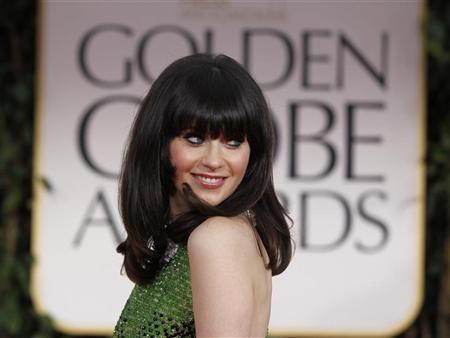 Actress Zooey Deschanel arrives at the 69th annual Golden Globe Awards in Beverly Hills